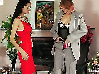 Lesbo chicks clothed in sexy nylons drinking wine in advance of strap-on sex