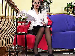 Female co-worker in black tights wetting jock previous to taking it up her muff