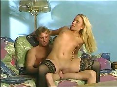 Horny babe in black stockings nailed in her cunt
