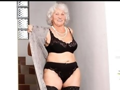 Granny with big breasts stuffs her shaggy juicy crack with a vibrator